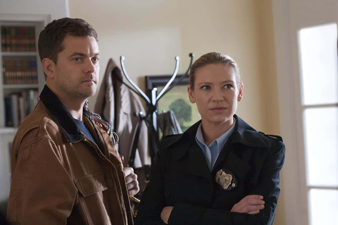 """FRINGE: Peter (Josh Jackson, L) and Olivia (Anna Torv, R) search a suspect's house in the """"And Those We've Left Behind"""" episode of Fringe airing Friday, Nov. 11 (9:00-10:00 PM ET/PT) on FOX. ©2011 Fox Broadcasting Co. CR: Liane Hentscher/FOX"""