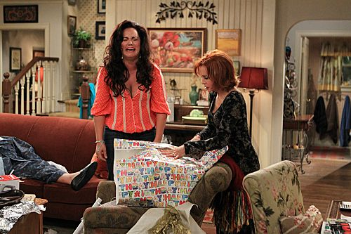 """The Honeymoon is Over"" -- Victoria Flynn (Katy Mixon, left) and Joyce Flynn (Swoosie Kurtz, right) take a sneak peak at Mike & Molly's wedding gifts. Photo: Sonja Flemming/CBS ©2012 CBS Broadcasting Inc. All Rights Reserved."