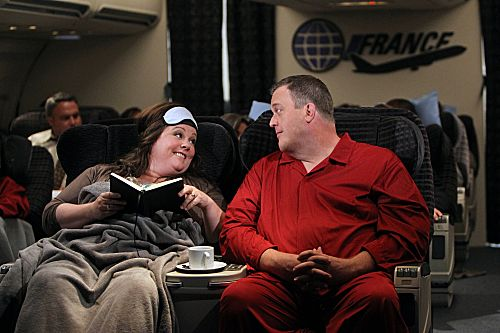 """The Honeymoon Is Over"" -- Mike (Billy Gardell) and Molly (Melissa McCarthy) get really comfortable in First Class on their flight back home from their honeymoon in Paris. Photo: Monty Brinton/CBS ©2012 CBS Broadcasting, Inc. All Rights Reserved."