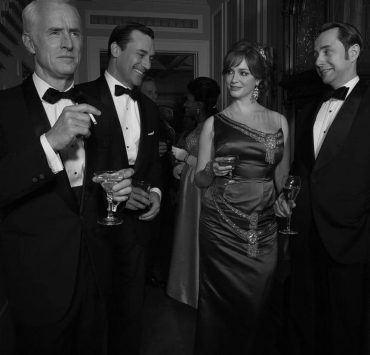 Roger Sterling (John Slattery), Don Draper (Jon Hamm), Joan Harris (Christina Hendricks) and Pete Campbell (Vincent Kartheiser) - Mad Men_Season 6, Teaser Gallery - Photo Credit: Frank Ockenfels/AMC