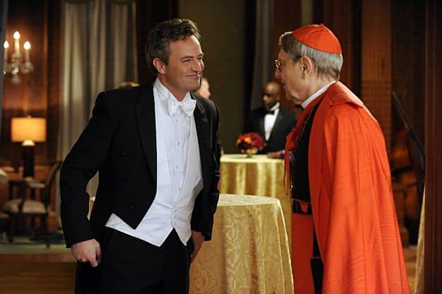 Mike Kresteva (Matthew Perry, left), Peter's political rival, tries to curry favor with Cardinal James (John Cullum, right)