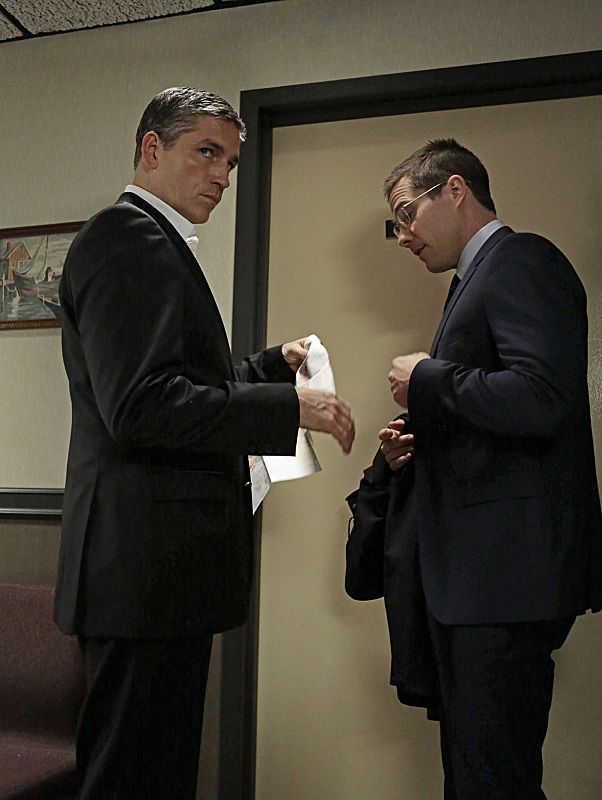 Reese (Jim Caviezel, left) joins forces with an FBI agent (Luke MacFarlane, right)