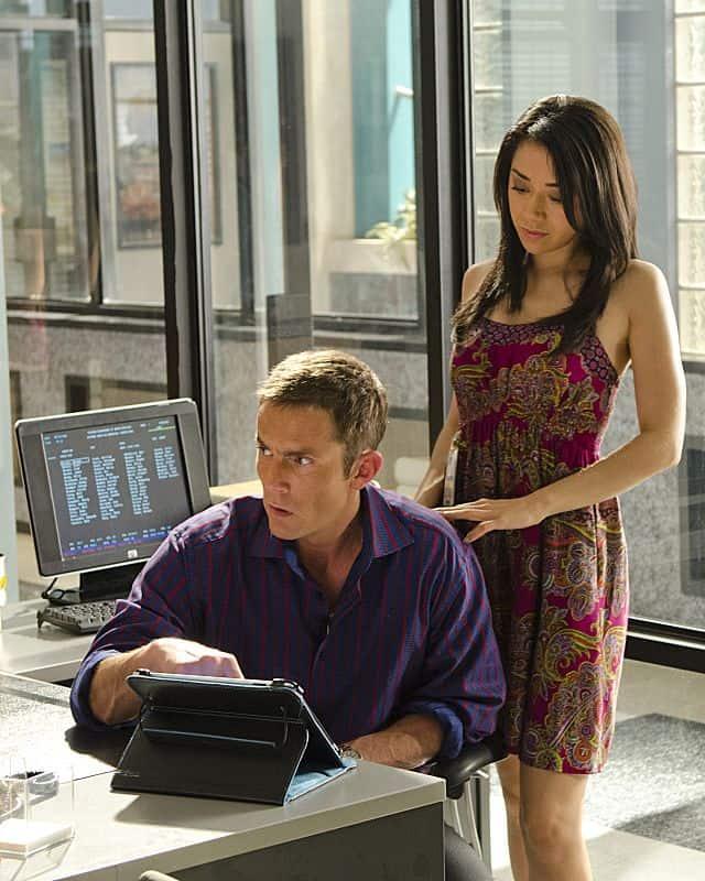 Aimee Garcia as Jamie Batista and Desmond Harrington as Joey Quinn in Dexter