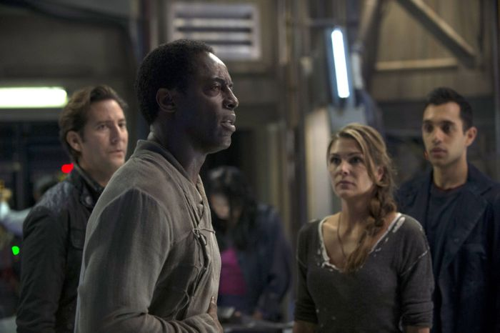 The 100 Isaiah Washington as Chancellor Jaha, Henry Ian Cusick as Kane, and Paige Turco as Abby