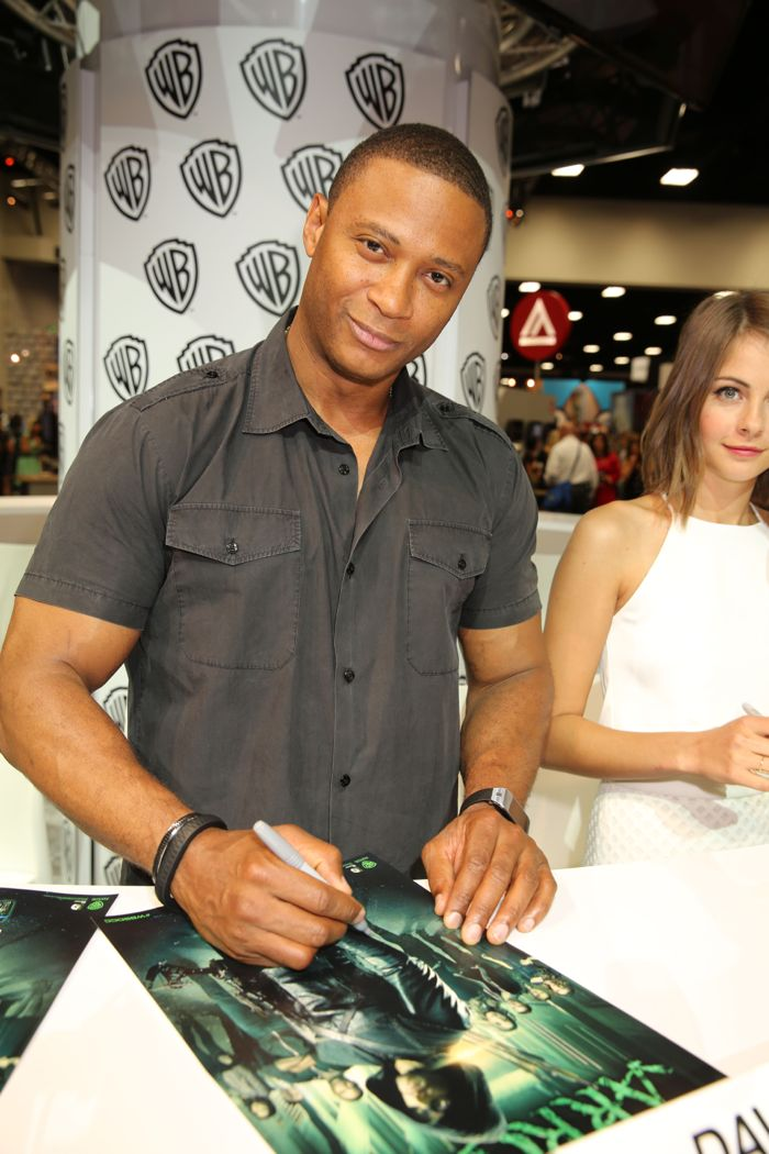 ARROW stars David Ramsey and Willa Holland sign for fans at the Warner Bros. booth at Comic-Con 2014