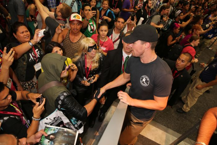 ARROW star Stephen Amell greets excited fans at the Warner Bros. booth at Comic-Con 2014
