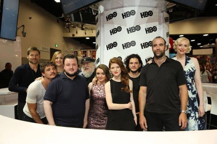 Stars of GAME OF THRONES gather for a group shot with the man who created the world of Westeros at the Warner Bros. booth at Comic-Con 2014. From L-R: Series stars Nikolaj Coster-Waldau, Pedro Pascal, Sophie Turner and John Bradley; author, writer and co-executive producer George R. R. Martin; series stars Maisie Williams, Rose Leslie, Kit Harington, Rory McCann and Gwendoline Christie
