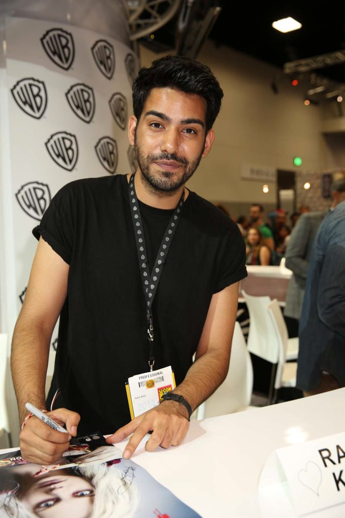 Rahul Kohli, who stars in iZOMBIE as Dr. Ravi Chakrabarti, signs for fans of the upcoming series at the Warner Bros. booth at Comic-Con 2014