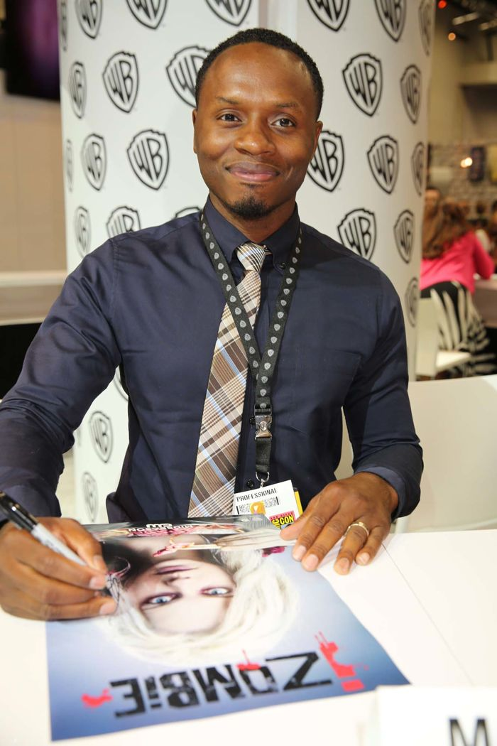 Malcolm Goodwin, who stars in iZOMBIE as Detective Clive Babineaux, signs for fans of the upcoming series at the Warner Bros. booth at Comic-Con 2014