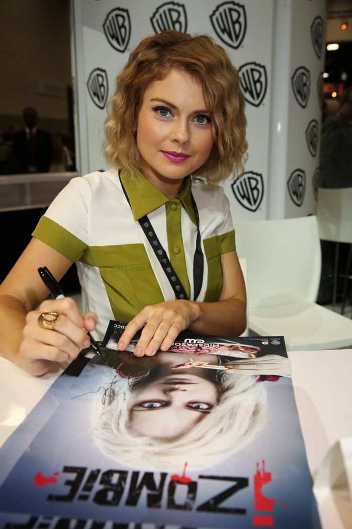 """Rose McIver, who stars in iZOMBIE as Olivia """"Liv"""" Moore, signs for fans of the upcoming series at the Warner Bros. booth at Comic-Con 2014"""