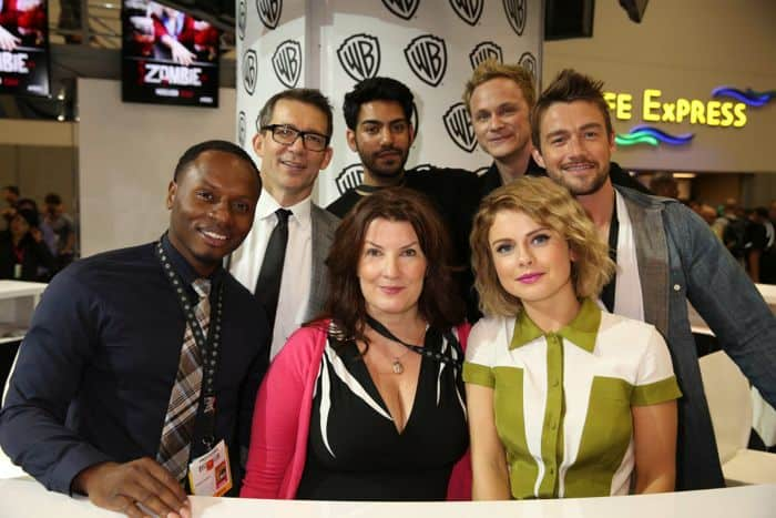 The iZOMBIE team at the Warner Bros. booth during Comic-Con 2014. Clockwise from left: Series star Malcolm Goodwin, co-creator and executive producer Rob Thomas, series stars Rahul Kohli, David Anders, Robert Buckley and Rose McIver, and co-creator and executive producer Diane Ruggiero-Wright.