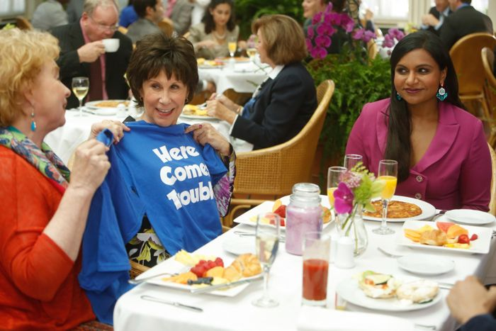 Mindy (Mindy Kaling, R) has a surprise for Danny's mother (guest star Rhea Pearlman, C)