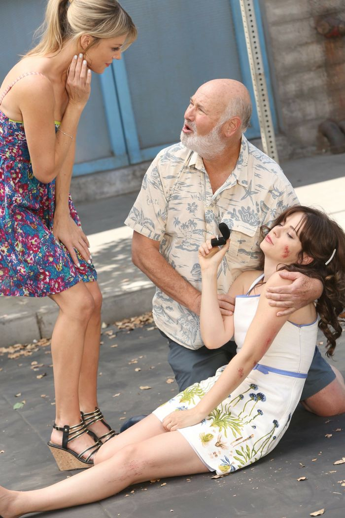 NEW GIRL: After being hit by a cyclist, Jess (Zooey Deschanel, R) helps her dad (guest star Rob Reiner, C) propose to his new girlfriend (guest star Kaitlin Olson, L)