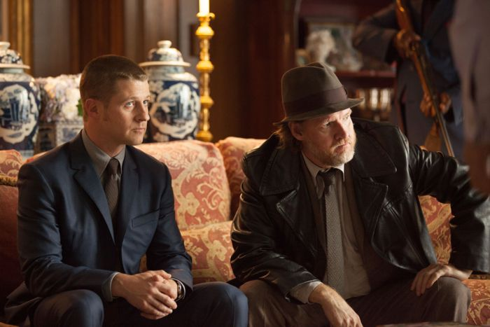 Detectives James Gordon (Ben McKenzie, L) and Harvey Bullock (Donal Logue, R) are confronted by Falcone's men Gotham