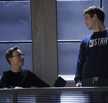 The Flash Tom Cavanagh as Harrison Wells and Grant Gustin as Barry Allen