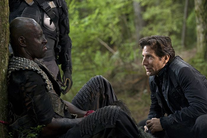 Colin Lawrence as Rivo and Henry Ian Cusick as Kane The 100