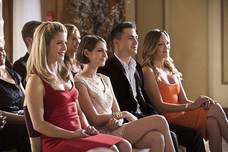 "Arrow -- ""Suicidal Tendencies"" -- Image AR317A_0243b -- Pictured (L-R): Emily Bett Rickards as Felicity Smoak, Willa Holland as Thea Queen, Colton Haynes as Roy Harper and Katie Cassidy as Laurel Lance -- Photo: Katie Yu/The CW -- © 2015 The CW Network, LLC. All Rights Reserved."