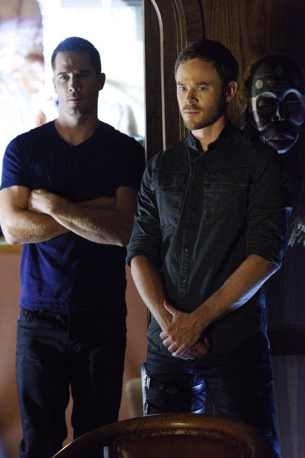 """KILLJOYS -- """"Bangarang"""" Episode 101 -- Pictured: (l-r) Luke Macfarlane as D'Avin, Aaron Ashmore as John -- (Photo by: Steve Wilkie/Syfy)"""