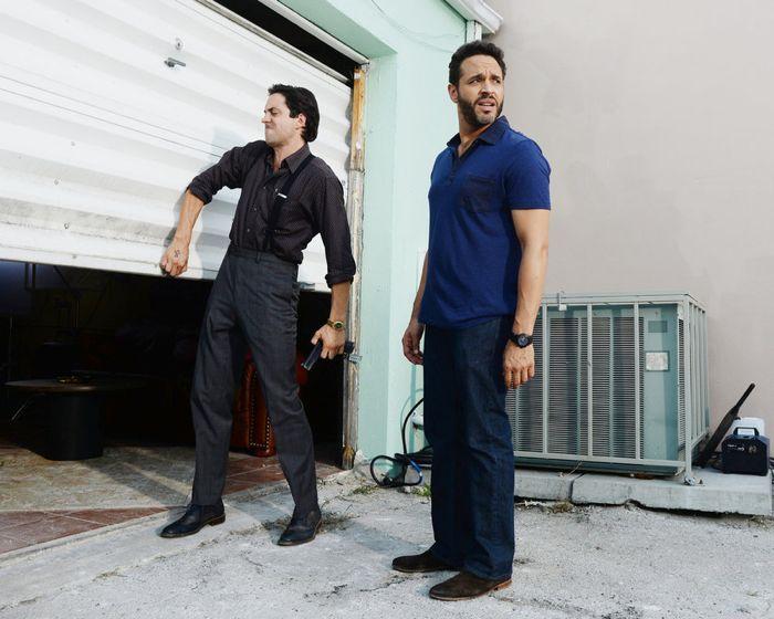 "GRACELAND -- ""Chester Cheeto"" Episode 302 -- Pictured: (l-r) Rhys Coiro as Ari, Daniel Sunjata as Paul Briggs -- (Photo by: Jeff Daly/USA Network)"