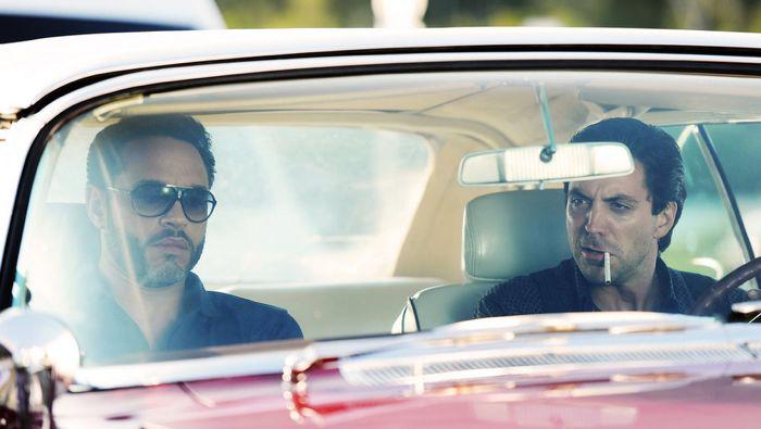 "GRACELAND -- ""Chester Cheeto"" Episode 302 -- Pictured: (l-r) Daniel Sunjata as Paul Briggs, Rhys Coiro as Ari -- (Photo by: Jeff Daly/USA Network)"