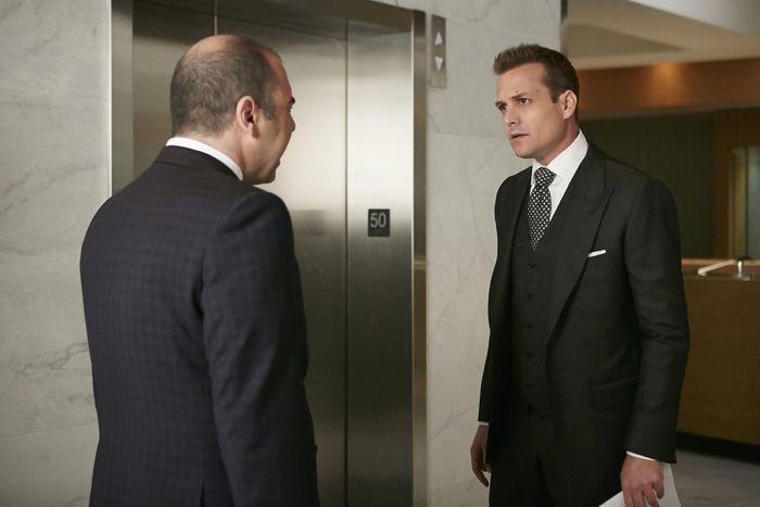 "SUITS -- ""Compensation"" Episode 502 -- Pictured: (l-r) Rick Hoffman as Louis Litt, Gabriel Macht as Harvey Specter -- (Photo by: Ian Watson/USA Network)"