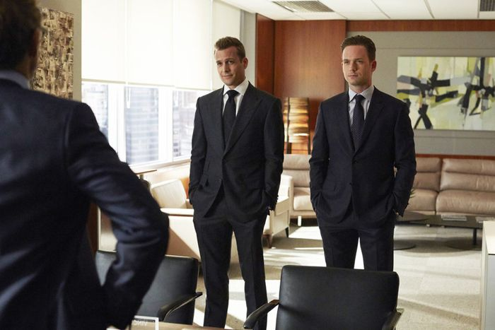 """SUITS -- """"Denial"""" Episode 501 -- Pictured: (l-r) Gabriel Macht as Harvey Specter, Patrick J. Adams as Michael Ross -- (Photo by: Shane Mahood/USA Network)"""