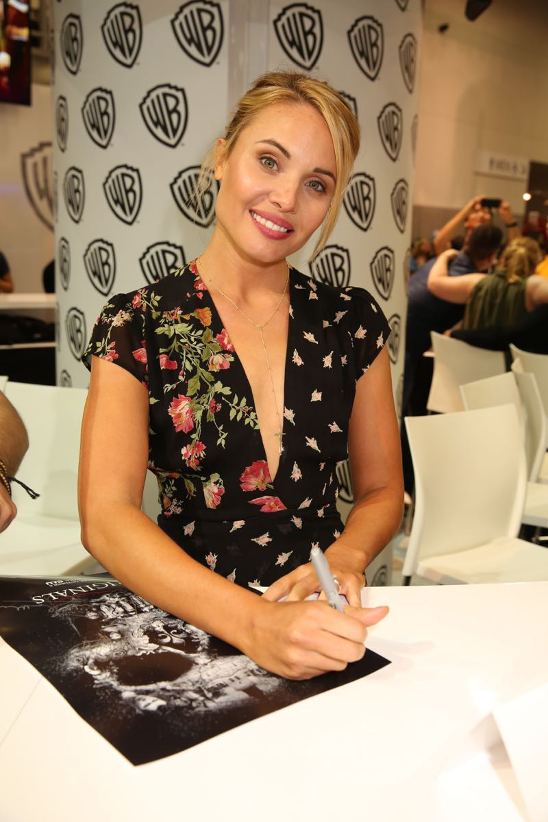 "THE ORIGINALS star Leah Pipes (Camille ""Cami"" O'Connell) gets ready for the show's signing in the Warner Bros. booth at Comic-Con 2015. #WBSDCC (©2015 WBEI. All rights reserved.)"