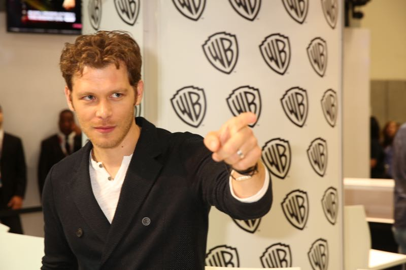 Joseph Morgan (Klaus Mikaelson) points to THE ORIGINALS fans who have gathered for the signing in the Warner Bros. booth at Comic-Con 2015. #WBSDCC (©2015 WBEI. All rights reserved.)