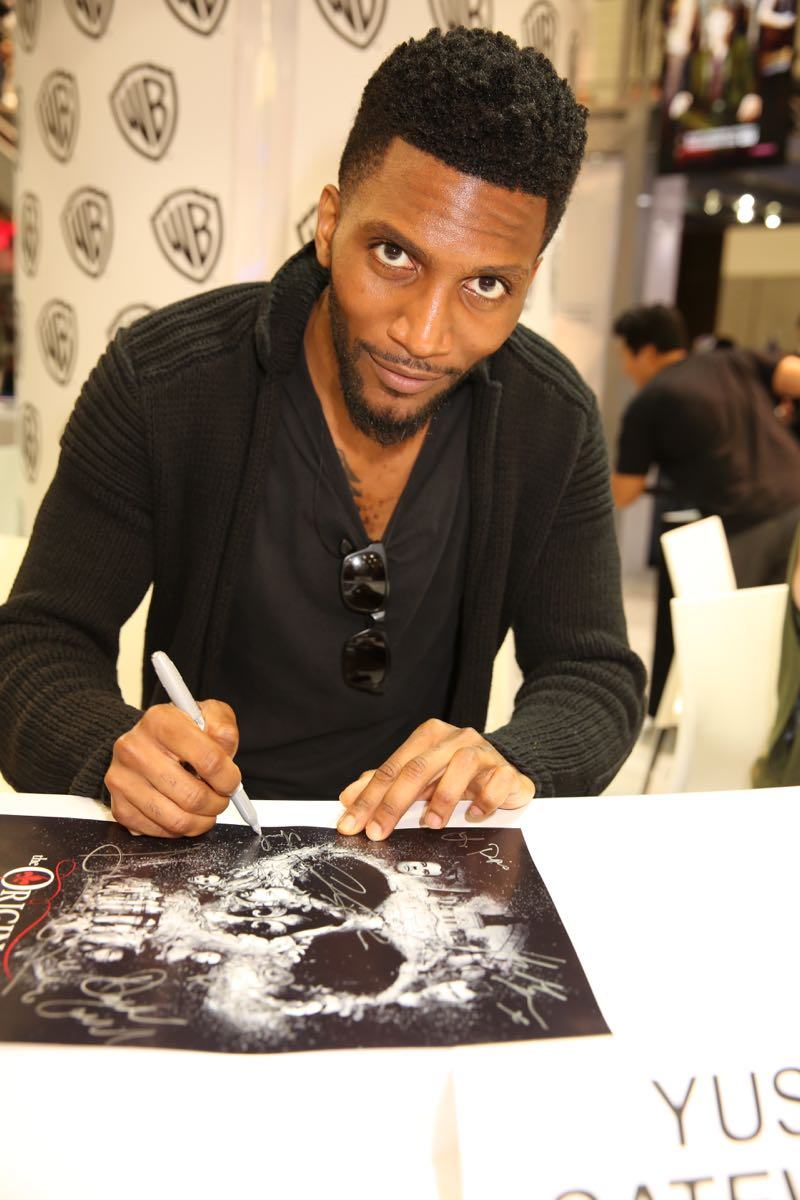 Yusuf Gatewood (Vincent) prepares to sign posters and meet fans at THE ORIGINALS signing in the Warner Bros. booth at Comic-Con 2015. #WBSDCC (©2015 WBEI. All rights reserved.)