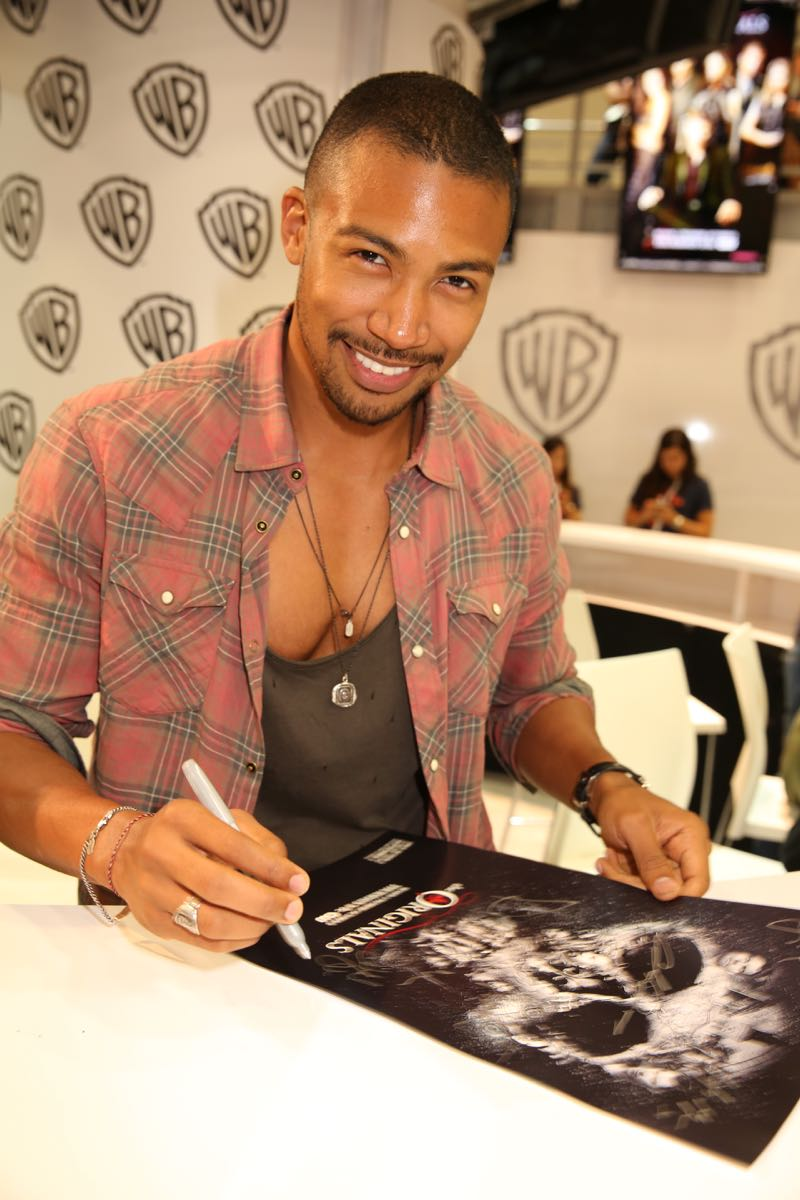 Prior to THE ORIGINALS signing, series star Charles Michael Davis, who plays Marcel Gerard in the sexy supernatural drama, hangs out in the Warner Bros. booth at Comic-Con 2015. #WBSDCC (©2015 WBEI. All rights reserved.)