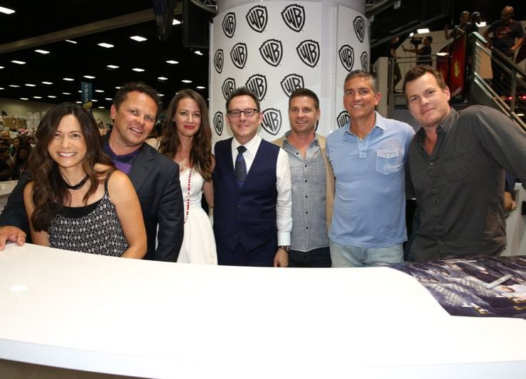 The PERSON OF INTEREST team (L-R) — executive producer Denise Thé; stars Kevin Chapman, Amy Acker and Michael Emerson; executive producer Greg Plageman; star Jim Caviezel; and executive producer Jonathan Nolan during the show's signing in the Warner Bros. booth on Saturday, July 11, at Comic-Con 2015. #WBSDCC (© 2015 WBEI. All Rights Reserved.)