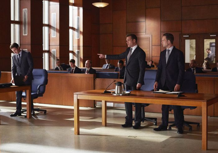 """SUITS -- """"Toe to Toe"""" Episode 505 -- Pictured: (l-r) Eric Close as Travis Tanner, Gabriel Macht as Harvey Specter, Patrick J. Adams as Michael Ross -- (Photo by: Shane Mahood/USA Network)"""
