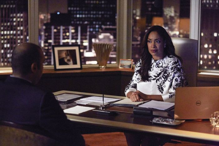 """SUITS -- """"Toe to Toe"""" Episode 505 -- Pictured: (l-r) Rick Hoffman as Louis Litt, Gina Torres as Jessica Pearson -- (Photo by: Shane Mahood/USA Network)"""