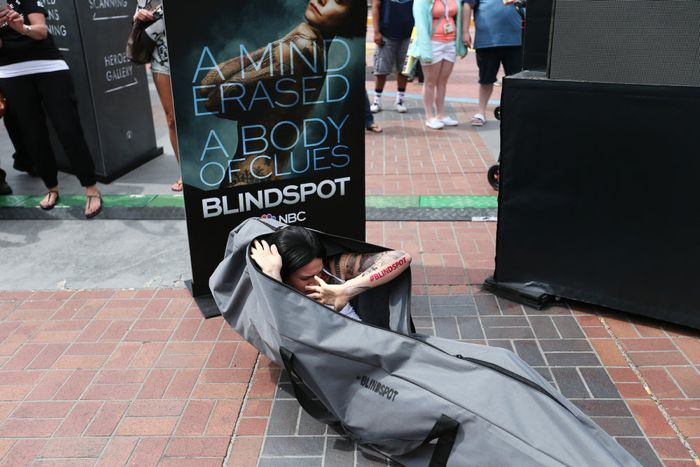"COMIC-CON INTERNATIONAL: SAN DIEGO 2015 -- ""Blindspot"" Jane Doe - Duffel Bag Stunt -- Pictured: Jane Doe Look-A-Like, Thursday, July 9, 2015, from Tin Fish Gaslamp, San Diego, Calif. -- (Photo by: Mark Davis/NBC)"