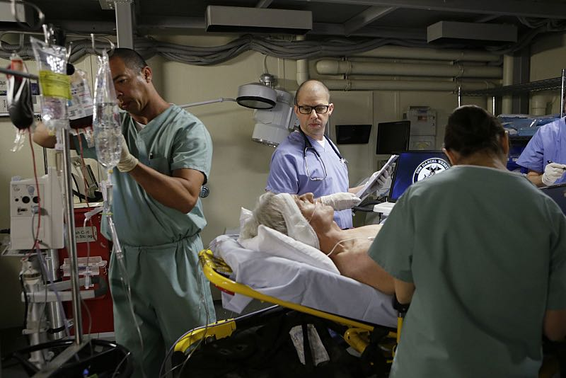 """Stop the Bleeding"" -- Gibbs (Mark Harmon) fights for his life aboard a Navy hospital ship after being shot, while DiNozzo and Joanna Teague travel to Shanghai to try and take down the Calling, on the 13th season premiere of NCIS, Tuesday, Sept. 22 (8:00-9:00 PM, ET/PT), on the CBS Television Network. Jon Cryer (Pictured holding chart) begins a multi-episode arc as Gibbs' surgeon, Dr. Cyril Taft.  Photo: Sonja Flemming/CBS ©2015 CBS Broadcasting, Inc. All Rights Reserved"