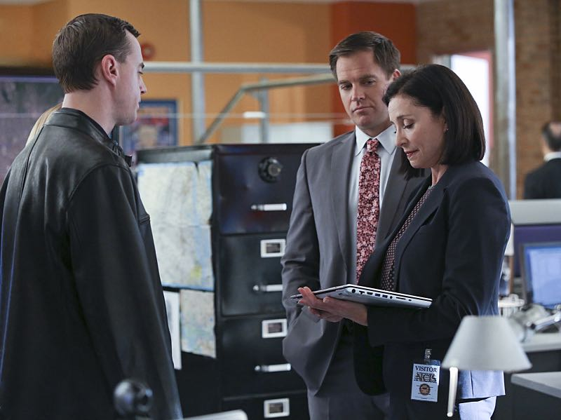 """Stop the Bleeding"" -- Gibbs fights for his life aboard a Navy hospital ship after being shot, while DiNozzo and Joanna Teague travel to Shanghai to try and take down the Calling, on the 13th season premiere of NCIS, Tuesday, Sept. 22 (8:00-9:00 PM, ET/PT), on the CBS Television Network. Pictured left to right: Sean Murray, Michael Weatherly and Mimi Rogers Photo: Monty Brinton/CBS ©2015 CBS Broadcasting, Inc. All Rights Reserved"