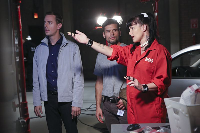"""Personal Day"" -- Gibbs calls on the team to assist DEA Agent Luis Mitchell (John Gabriel, center) with a case that keeps going cold, but DiNozzo discovers there is more to Gibbs' personal connection to the agent and his desire to help him succeed. Also, the team gossips about Gibbs' new look after he replaces his standard military haircut and polo shirt for a modern cut and tailored dress shirt, on NCIS, Tuesday, Sept. 29 (8:00-9:00 PM, ET/PT), on the CBS Television Network. Also pictured left to right: Sean Murray (left) and Pauley Perrette (right) Photo: Monty Brinton/CBS ©2015 CBS Broadcasting, Inc. All Rights Reserved"