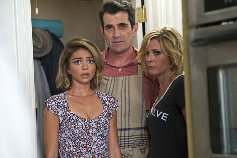 """MODERN FAMILY - """"Summer Lovin'"""" - Emmy award winning and critically acclaimed series """"Modern Family"""" returns for its seventh season with the premiere episode, """"Summer Lovin,"""" on WEDNESDAY, SEPTEMBER 23 (9:00-9:31 p.m., ET) on the ABC Television Network. Haley's attempt to stop Andy from proposing to Beth will end up with both Haley and Andy needing to cope with their emotions and both will have their own special ways of doing so, and Phil and Claire seem to only make matters worse. Jay and Gloria look at pre-schools for Joe and get a rude awakening after they realize the competitive wait list to get in. Meanwhile, Cam tries to remain supportive of Mitch's midlife career crisis, but money is getting a little tight, so Cam comes up with a scheme to get Mitch's old job back. (ABC/Eric McCandless) SARAH HYLAND, TY BURRELL, JULIE BOWEN"""