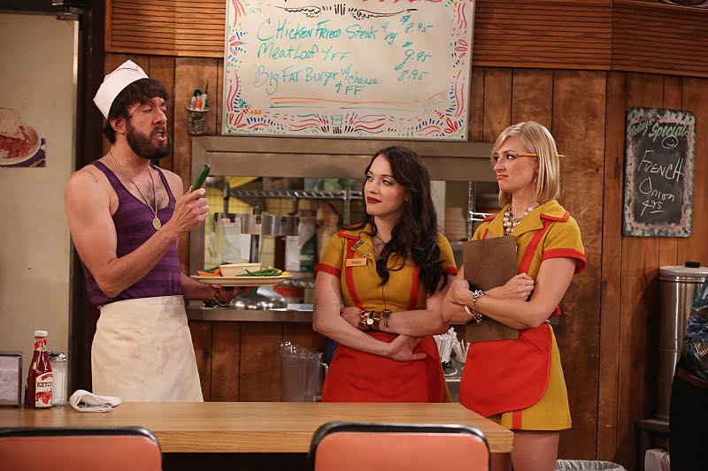 """And the Wrecking Ball"" -- Max and Caroline team up with the diner staff in a frantic attempt to keep their businesses open when the city targets Han's diner and their cupcake window for destruction. Also, Sophie and Oleg announce that they are trying to have a baby, on the fifth season premiere of 2 BROKE GIRLS, Thursday, November 12 (9:30-10:00 PM, ET/PT) on the CBS Television Network. From left, Oleg (Jonathan Kite), Max Black (Kat Dennings) and Caroline Channing (Beth Behrs), shown. Photo: Monty Brinton/CBS ©2015 CBS Broadcasting, Inc. All Rights Reserved"