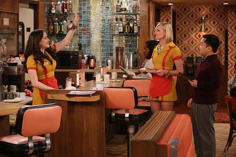 """And the Wrecking Ball"" -- Max and Caroline team up with the diner staff in a frantic attempt to keep their businesses open when the city targets Han's diner and their cupcake window for destruction. Also, Sophie and Oleg announce that they are trying to have a baby, on the fifth season premiere of 2 BROKE GIRLS, Thursday, November 12 (9:30-10:00 PM, ET/PT) on the CBS Television Network. From left, Max Black (Kat Dennings), Caroline Channing (Beth Behrs) and Han Lee (Matthew Moy), shown. Photo: Monty Brinton/CBS ©2015 CBS Broadcasting, Inc. All Rights Reserved"