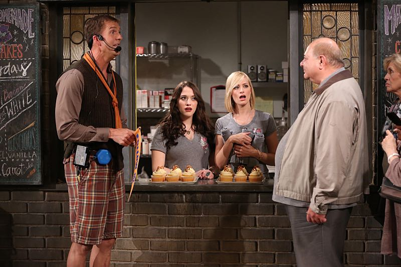 """And the Wrecking Ball"" -- Max and Caroline team up with the diner staff in a frantic attempt to keep their businesses open when the city targets Han's diner and their cupcake window for destruction. Also, Sophie and Oleg announce that they are trying to have a baby, on the fifth season premiere of 2 BROKE GIRLS, Thursday, November 12 (9:30-10:00 PM, ET/PT) on the CBS Television Network. From left, Dannon (Regan Burns), Max Black (Kat Dennings) and Caroline Channing (Beth Behrs), shown. Photo: Monty Brinton/CBS ©2015 CBS Broadcasting, Inc. All Rights Reserved"