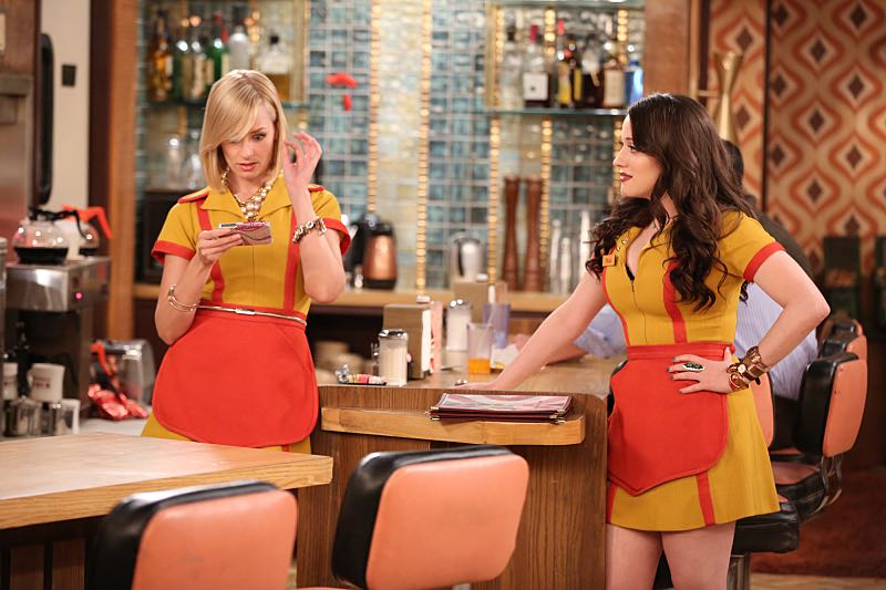 """And the Wrecking Ball"" -- Max and Caroline team up with the diner staff in a frantic attempt to keep their businesses open when the city targets Han's diner and their cupcake window for destruction. Also, Sophie and Oleg announce that they are trying to have a baby, on the fifth season premiere of 2 BROKE GIRLS, Thursday, November 12 (9:30-10:00 PM, ET/PT) on the CBS Television Network. From left, Caroline Channing (Beth Behrs) and Max Black (Kat Dennings), shown. Photo: Monty Brinton/CBS ©2015 CBS Broadcasting, Inc. All Rights Reserved"