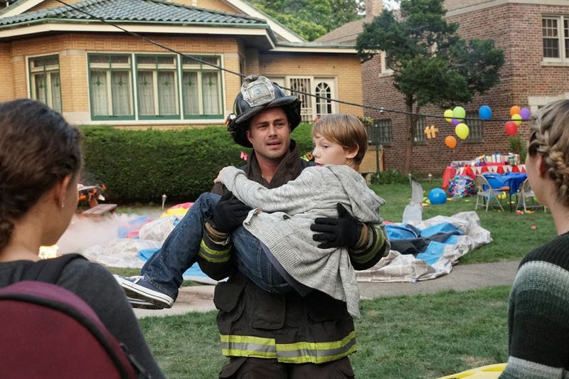 "CHICAGO FIRE -- ""Your Time Is Coming"" Episode 404 -- Pictured: (l-r) Taylor Kinney as Kelly Severide, Jaden Klein as Kevin Sullivan -- (Photo by: Elizabeth Morris/NBC)"