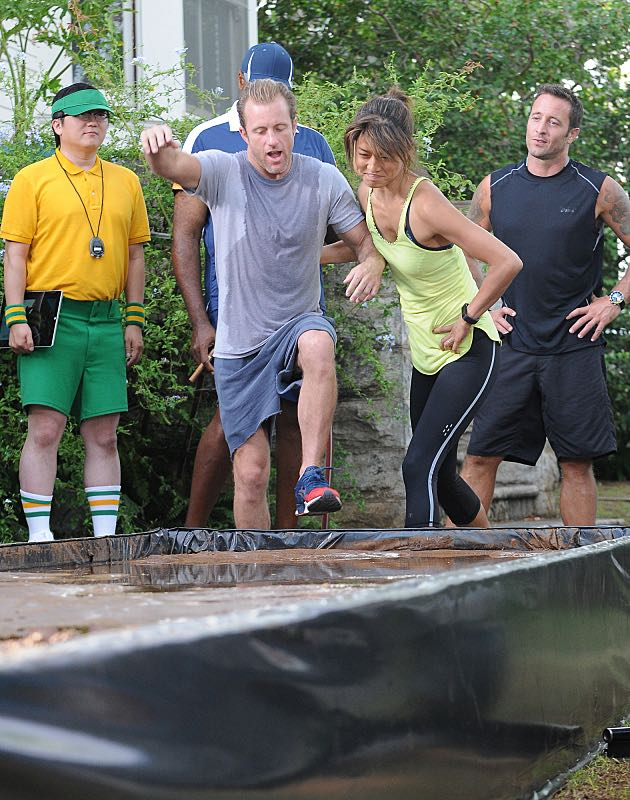 """""""Ka 'alapahi nui"""" -- Five-0 must interrogate members of a stunt bikers gang to find a killer who escaped by jumping his motorcycle from one roof onto another.  Also, the team prepares to race in a Tough Mudder competition, on HAWAII FIVE-0, Friday, Oct. 23 (9:00-10:00 PM, ET/PT), on the CBS Television Network.  American daredevil Robbie Knievel guest stars. (*""""Ka 'alapahi nui"""" is Hawaiian for """"Big Lie"""") From left, Dr. Max Bergman (Masi Oka), Danny """"Danno"""" Williams (Scott Caan), Kono Kalakaua (Grace Park) and Steve McGarrett (Alex O'Loughlin), shown. Photo: Norman Shapiro/CBS ©2015 CBS Broadcasting, Inc. All Rights Reserved"""