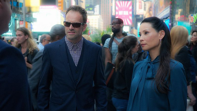 """""""Evidence of Things Not Seen"""" -- When Morland offers to use his influence to have Sherlock and Joan reinstated as consultants to the NYPD, Sherlock's mistrust of his father makes him question his motivation to help. Also, with no work offers coming in, Watson wrangles a gig with the FBI investigating a triple homicide in a top-secret research lab, on ELEMENTARY, Thursday, Nov. 12 (10:00-11:00 PM, ET/PT) on the CBS Television Network. Pictured (L-R) Jonny Lee Miller as Sherlock Holmes and Lucy Liu as Joan Watson Photo: Michael Parmelee/CBS © 2015 CBS Broadcasting Inc. All Rights Reserved."""