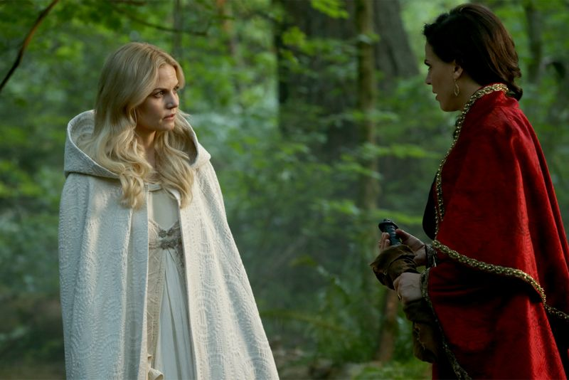 """ONCE UPON A TIME - """"Dreamcatcher"""" - In Camelot, as Mary Margaret and David attempt to retrieve the Dark One dagger, Emma uses a dreamcatcher to look into the past to see how Merlin was transformed into a tree. Together, Emma and Regina figure out the critical ingredient they must acquire to free Merlin, but it's a race against Arthur, who does not want Merlin released. Meanwhile, with encouragement from his moms, Henry musters up the courage to ask Violet on a date. Back in Storybrooke, the heroes break into Emma's house hoping to locate Gold, but what they find will give them a glimpse of Emma's end game. Far from prying eyes, Merida sets about the mission Emma has tasked her with and begins molding Gold into the hero they need to draw Excalibur, on """"Once Upon a Time,"""" SUNDAY, OCTOBER 25 (8:00-9:00 p.m., ET) on the ABC Television Network. (ABC/Jack Rowand) JENNIFER MORRISON, LANA PARRILLA"""