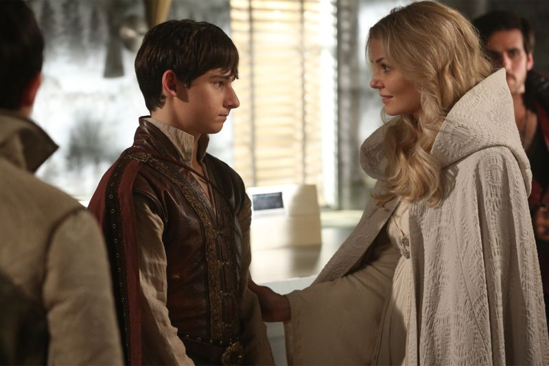 """ONCE UPON A TIME - """"Dreamcatcher"""" - In Camelot, as Mary Margaret and David attempt to retrieve the Dark One dagger, Emma uses a dreamcatcher to look into the past to see how Merlin was transformed into a tree. Together, Emma and Regina figure out the critical ingredient they must acquire to free Merlin, but it's a race against Arthur, who does not want Merlin released. Meanwhile, with encouragement from his moms, Henry musters up the courage to ask Violet on a date. Back in Storybrooke, the heroes break into Emma's house hoping to locate Gold, but what they find will give them a glimpse of Emma's end game. Far from prying eyes, Merida sets about the mission Emma has tasked her with and begins molding Gold into the hero they need to draw Excalibur, on """"Once Upon a Time,"""" SUNDAY, OCTOBER 25 (8:00-9:00 p.m., ET) on the ABC Television Network. (ABC/Jack Rowand) JARED GILMORE, JENNIFER MORRISON"""