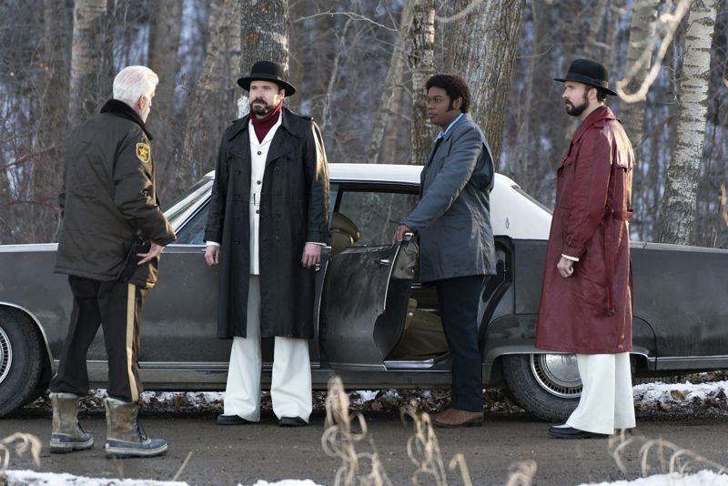 "FARGO -- ""Before The Law"" -- Episode 202 (Airs October 19, 10:00 pm e/p) Pictured: (l-r) Ted Danson as Hank Larsson, Todd Mann as Wayne Kitchen, Bokeem Woodbine as Mike Milligan, Brad Mann as Gale Kitchen. CR: Chris Large/FX"