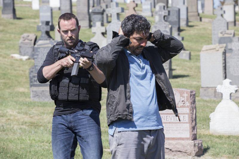 "BLINDSPOT -- ""Split The Law"" Episode 105 -- Pictured: (l-r) Sullivan Stapleton as Kurt Weller, Ayman Samman as Dodi -- (Photo by: Paul Sarkis/NBC)"