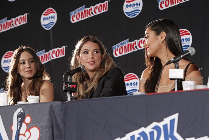 "PRETTY LITTLE LIARS - Lucy Hale, Shay Mitchell, Ashley Benson, Troian Bellisario and Sasha Pieterse as well as Executive producers Marlene King, Oliver Goldstick and Joseph Dougherty assemble at Comic-Con New York to preview the new mystery facing the girls when ""Pretty Little Liars"" returns in January 2016. (ABC Family/Lou Rocco) TROIAN BELLISARIO, ASHLEY BENSON, SHAY MITCHELL"